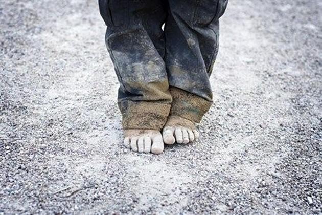 L'immagine di un bambino povero