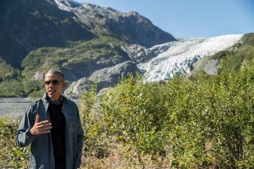 FILE - In this Sept. 1, 2015 file photo, President Barack Obama speaks to members of the media while on a hike to the Exit Glacier in Seward, Alaska. After an emotionally trying week, the president is heading West to celebrate the raw beauty of America's national parks as the system nears its 100th birthday, and highlight challenges threatening it over the next 100 years, including climate change and chronic underfunding by Congress. Obama was taking his wife and daughters on a Father's Day weekend getaway to Carlsbad Caverns National Park in New Mexico and Yosemite National Park in California. (AP Photo/Andrew Harnik, File)