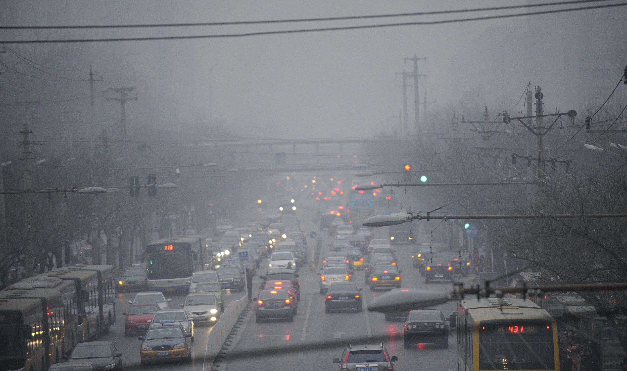 """Cars pass along a road in thick smog in Beijing on February 21, 2011. Beijing went """"beyond"""" measurable pollution levels, the US embassy said, as a Chinese official warned people to stay indoors and avoid outdoor activities. Air pollution in Beijing has been consistently listed as among the worst in the world by international organisations such as the United Nations.             AFP PHOTO/GOH CHAI HIN (Photo credit should read GOH CHAI HIN/AFP/Getty Images)"""