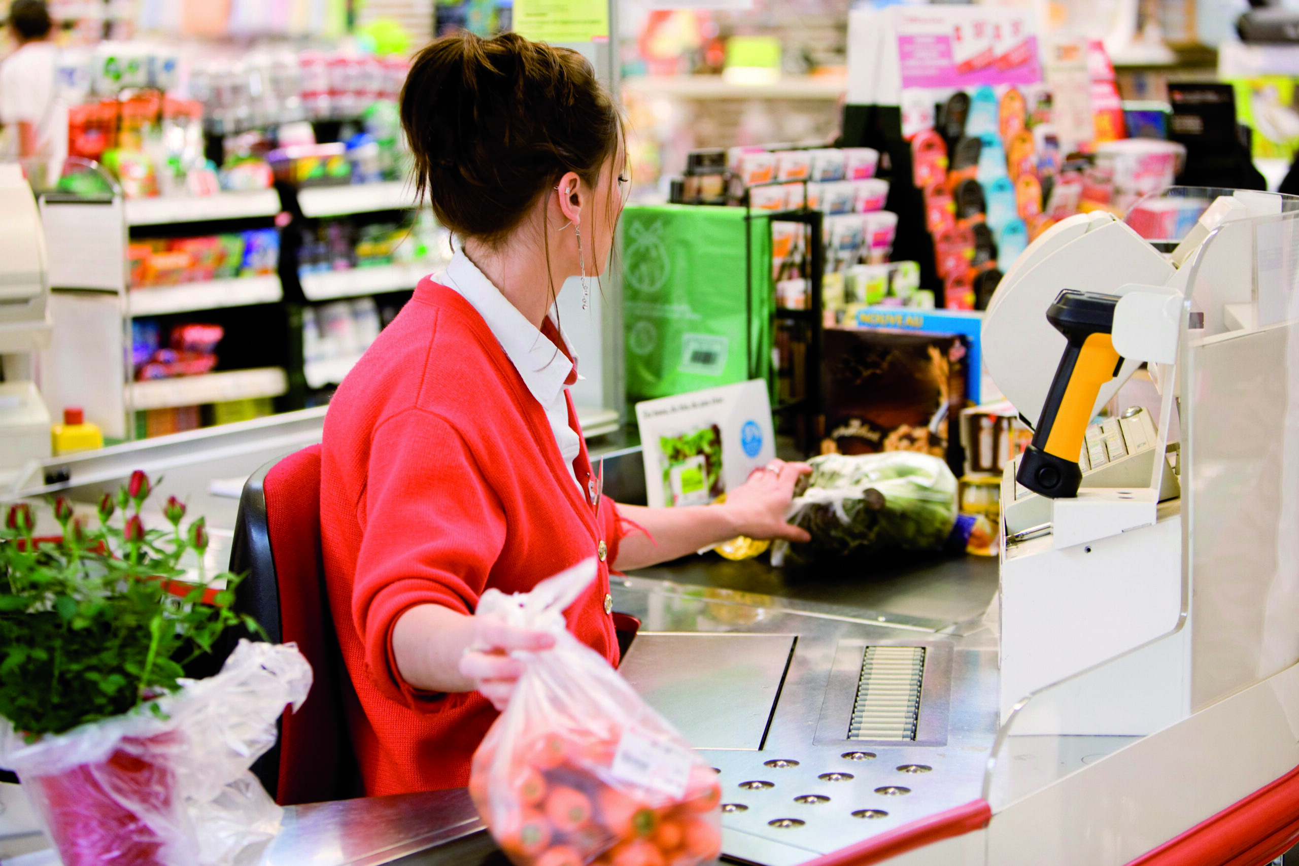 Cashier totaling grocery purchases No third party sales.